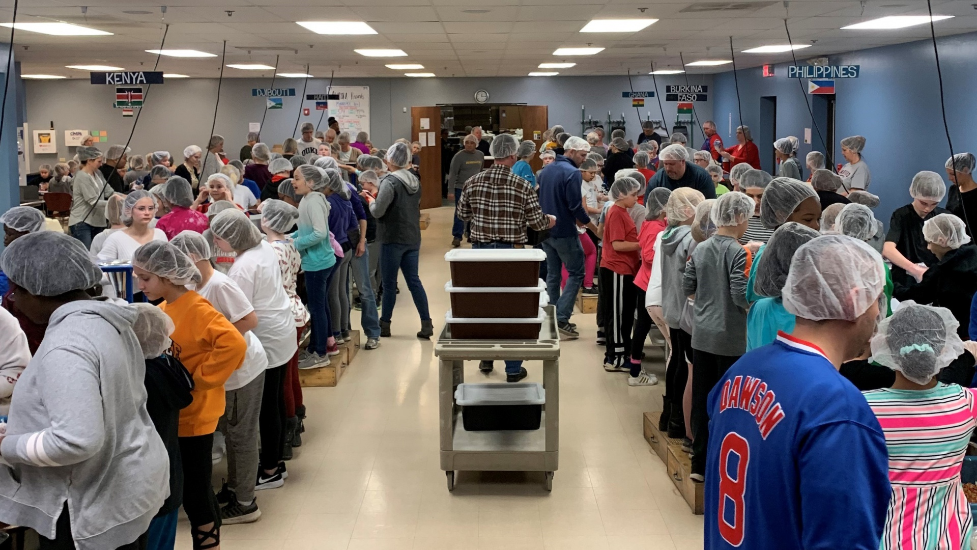 slidshow image - 5th Grade works to feed hungry children - Field Trip to Feed My Starving Children